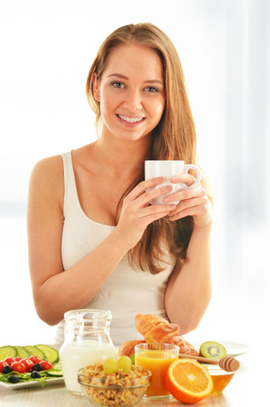 balanced diet: Young woman having breakfast  Balanced diet