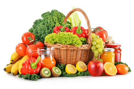 Composition with variety organic vegetables and fruits in wicker basket isolated on white photo