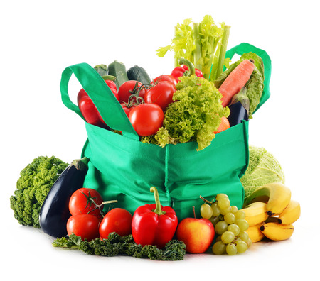 groceries shopping: Green shopping bag with variety of fresh organic vegetables isolated on white
