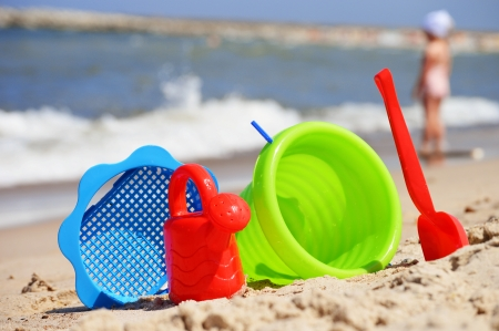 Plastic children toys on the sand beach photo