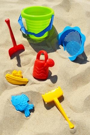 sand mold: Plastic children toys on the sand beach
