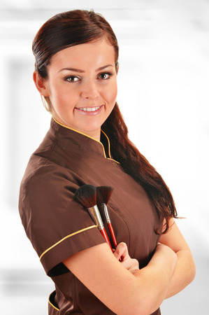 age care: Professional beautician holding brushes
