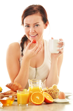 egg roll: Young woman having breakfast  Balanced diet