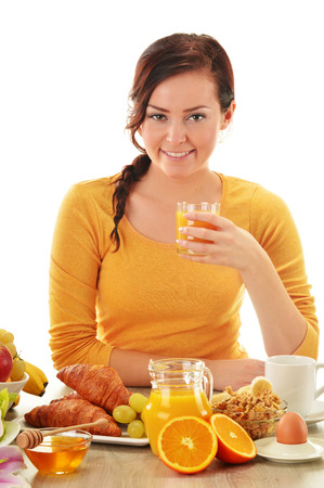Young woman having breakfast  Balanced diet photo
