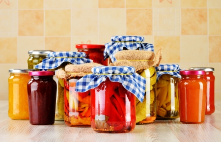 Composition with jars of marinated food  Pickled vegetables and jams photo