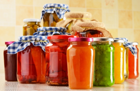 Composition with jars of marinated food  Pickled vegetables and jams Stockfoto