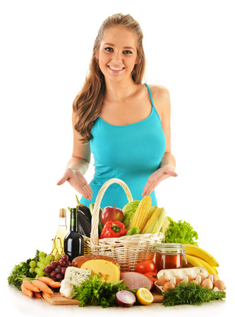 Young woman with assorted grocery products isolated on white  photo