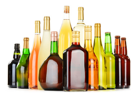 Bottles of assorted alcoholic beverages isolated on white background photo