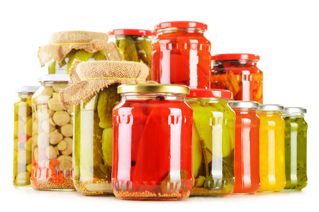 Composition with jars of pickled vegetables isolated on white. Marinated food Stockfoto