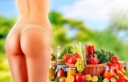 Woman Balanced diet body with raw organic vegetables photo