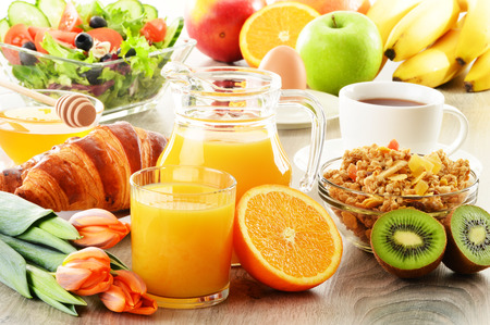 breakfast hotel: Breakfast with coffee, juice, croissant, salad, muesli and egg Stock Photo