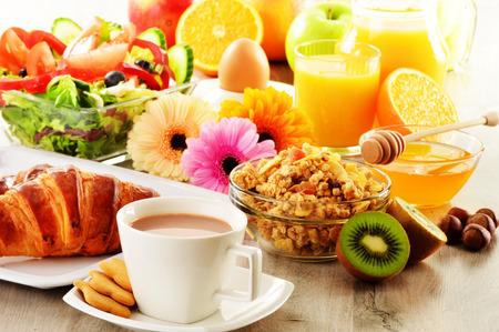 buffet table: Breakfast with coffee, juice, croissant, salad, muesli and egg Stock Photo