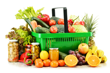Plastic shopping basket with groceries isolated on white background photo