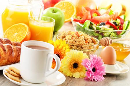 Breakfast with coffee, juice, croissant, salad, muesli and egg. Swedish buffet photo