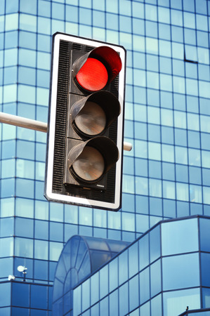 Traffic lights over modern business architecture photo