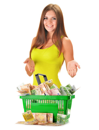 inflation basket: Young woman with plastic shopping bag full of paper money isolated on white