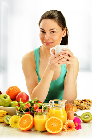 Young woman having breakfast. Balanced diet. photo