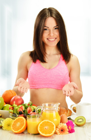Young woman having breakfast. Balanced diet. photo
