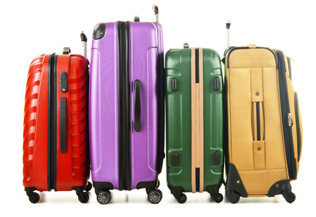 packing suitcase: Four suitcases isolated on white background Stock Photo