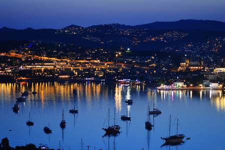 View of Gumbet Bay by night. Turkish Riviera. photo