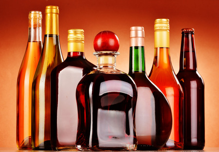 excise: Bottles of assorted alcoholic beverages including beer and wine