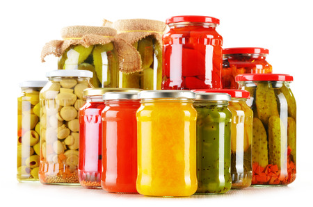 Composition with jars of pickled vegetables isolated on white  Marinated food photo