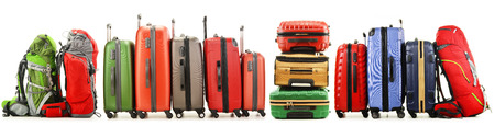 Luggage consisting of large suitcases and backpacks isolated on white  Stock Photo
