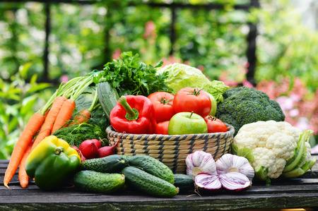 detoxification: Fresh organic vegetables in wicker basket in the garden  Stock Photo