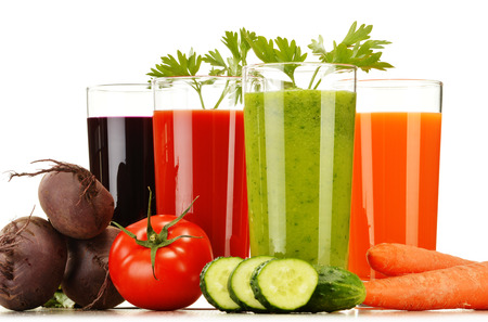 carrot juice: Glasses with fresh vegetable juices isolated on white  Detox diet