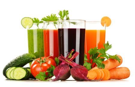 Glasses with fresh vegetable juices isolated on white  Detox diet