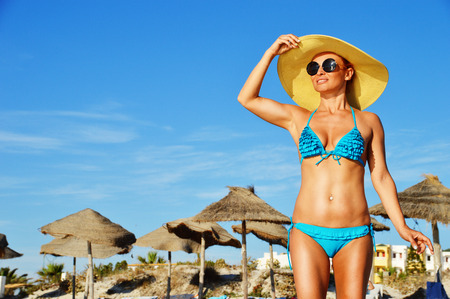turkey beach: Young woman on the mediterranean beach during hot summer day Stock Photo