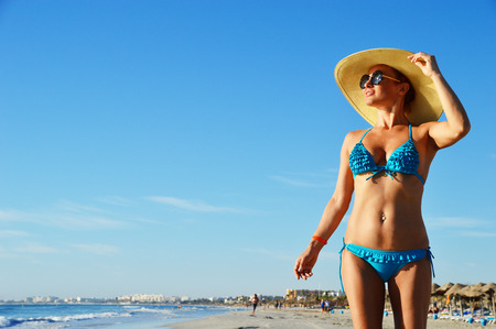 Young woman on the mediterranean beach during hot summer day Stock Photo