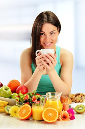 Young woman having breakfast  Balanced diet  photo