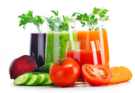 Glasses with fresh vegetable juices isolated on white. Detox diet. photo