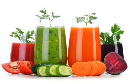detox: Glasses with fresh vegetable juices isolated on white. Detox diet.