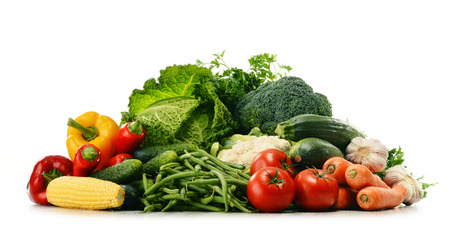 balanced diet: Variety of fresh organic vegetables isolated on white background