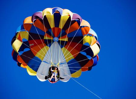 parasailing: Parasailing over the blue sky