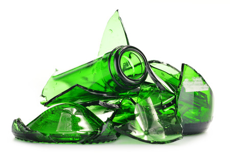 Pieces of broken glass over white background. Recycling. photo