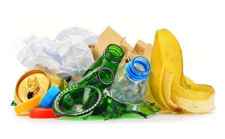 Composition with recyclable garbage consisting of glass, plastic, metal and paper isolated on white background photo