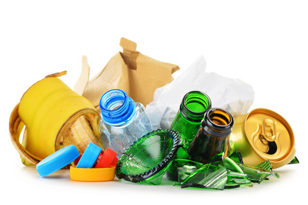 metal recycling: Composition with recyclable garbage consisting of glass, plastic, metal and paper isolated on white background