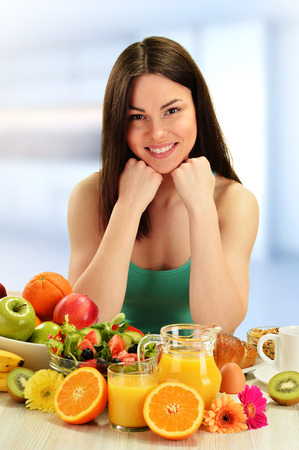 balanced diet: Young woman having breakfast. Balanced diet. Stock Photo