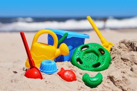 sand mold: Plastic children toys on the sand beach.