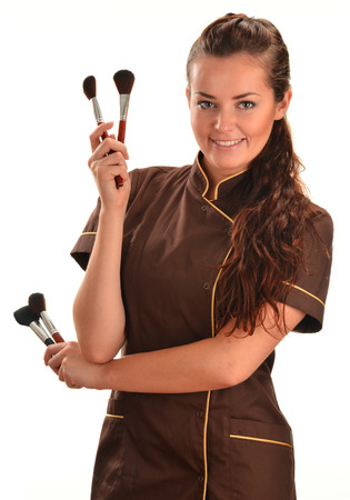 Professional beautician holding brushes photo