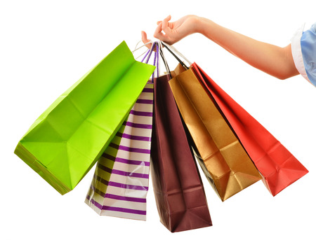 woman bag: Female hand holding paper shopping bags isolated on white background