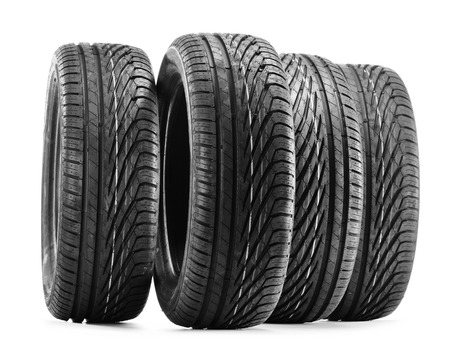 winter tyre: Four new black tires isolated on white background Stock Photo