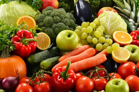 eating fruit: Composition with assorted raw organic vegetables Stock Photo