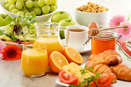breakfast hotel: Breakfast consisting of fruits, orange juice, coffee, honey, bread and egg. Balanced diet