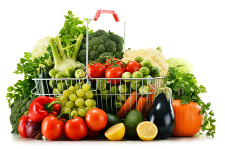 Shopping basket with assorted raw organic vegetables isolated on white photo