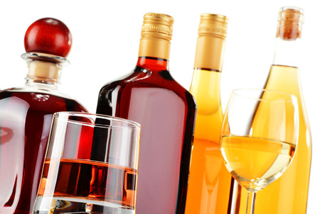 excise: Bottles and glasses of assorted alcoholic beverages isolated on white background
