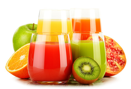 multivitamin: Composition with glasses of assorted fruit juices isolated on white. Detox diet